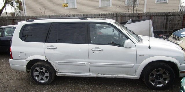 Police said Aaron Weddles and Princess Canez-Walker were living out of this white Suzuki with their five children.