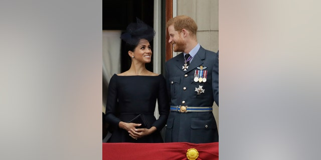 Meghan the Duchess of Sussex was all smiles through her second appearance on the balcony of Buckingham Palace.