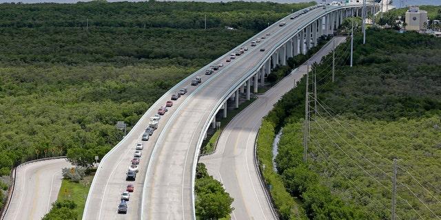 Motorists head north on US 1, Wednesday, Sept. 6, 2017, north of Key Largo, Fla.