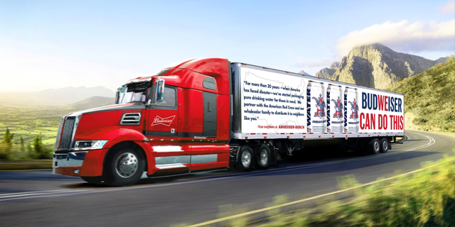 """Anheuser-Busch debuted new trucks and cans that """"capture the spirit"""" of the emergency water program, the company said in a news release."""
