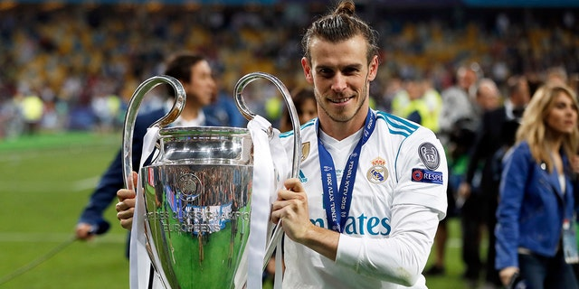 Real Madrid's Gareth Bale holds the UEFA Champions League trophy after Saturday's win over Liverpool in Kiev, Ukraine.