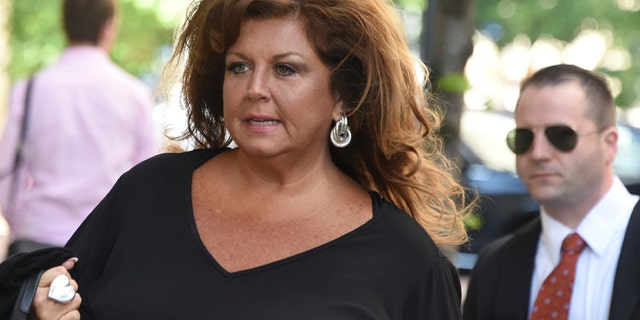 FILE -- Abby Lee Miller, pictured here arriving at the Joseph F. Weis Jr. U. S. Courthouse in Pittsburgh for her sentencing on federal bankruptcy fraud charges, Monday, May 8, 2017, has been accused of previously making racist remarks.