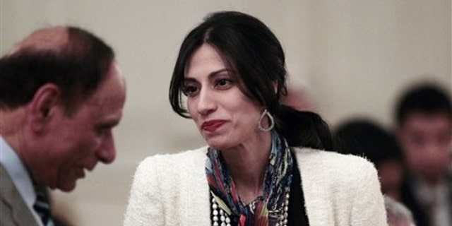 Huma Abedin's career includes service as a top aide to Hillary Clinton.