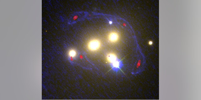 This image shows the four central galaxies in the Abell 3827 cluster with ultraviolet light from the Hubble images (blue) and infrared light from the ALMA observations (red). At these wavelengths, scientists can determine the extent to which a galaxy behind the cluster has been distorted by the gravity of the normal and dark matter.