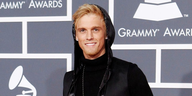 FILE PHOTO: Singer Aaron Carter poses on the red carpet at the 52nd annual Grammy Awards in Los Angeles January 31, 2010. REUTERS/Mario Anzuoni/File Photo - RC164BD8E5F0