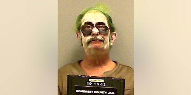 "This booking photo provided by the Somerset County Sheriff's Department shows Dennis Lalime, arrested Sunday, Oct. 20, 2013, when returning from a Halloween party made up as ""The Joker,"" and charged with drunken driving after crashing his car in Pittsfield, Maine. (AP Photo/ Somerset County Sheriff's Department)"