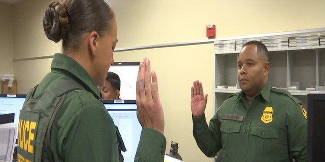 A Border Patrol recruit reads an instructor, playing an illegal immigrant, his miranda rights in Spanish.