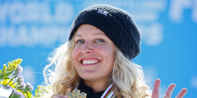 Snowboarder Lindsey Jacobellis doesn't agree with the idea of wearing black at the Games.