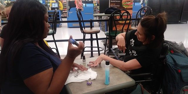 The pair bought a bottle of nail polish and set up a salon at one of the tables at the Walmart.