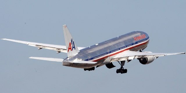FILE -An American Airlines airplane takes off at Miami International Airport in Miami.
