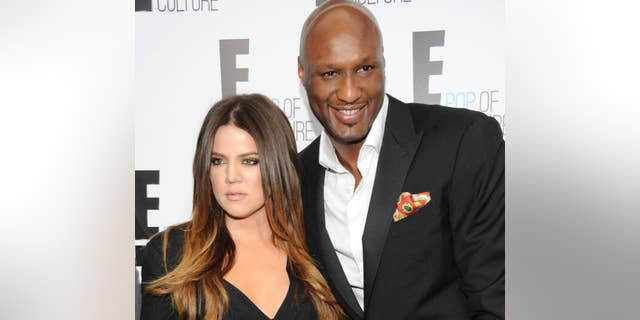 "FILE - In this April 30, 2012, file photo, Khloe Kardashian Odom and Lamar Odom from the show ""Keeping Up With The Kardashians"" attend an E! Network upfront in New York."