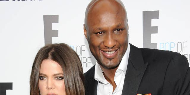 FILE - In this Apr 30, 2012, record photo, Khloe Kardashian Odom and Lamar Odom from a uncover Keeping Up With The Kardashians attend an E! Network upfront in New York.