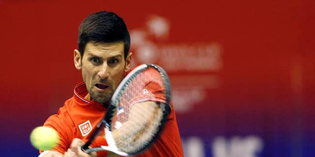 """FILE - In this April 7, 2017 file photo, Serbia's Novak Djokovic returns the ball to Spain's Albert Ramos-Vinolas during their Davis Cup quarterfinal tennis match, in Belgrade, Serbia. Djokovic has split with his longtime coach Marian Vajda and two other team members, saying he wants to find """"the winning spark on the court again."""" Djokovic said on his website on Friday, May 5 that he """"mutually agreed"""" with Vajda, fitness coach Gebhard Phil Gritsch, and physiotherapist Miljan Amanovic to end their """"successful and long term partnership"""" two weeks ago after the Monte Carlo Masters, where he lost in quarterfinals.  (AP Photo/Darko Vojinovic, File)"""