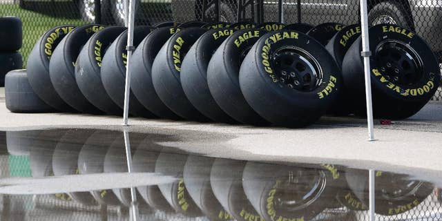 Race tires are stacked next to a rain puddle at Kansas Speedway in Kansas City, Kan., Thursday, May 7, 2015. Wet weather is expected over the weekend. (AP Photo/Orlin Wagner)