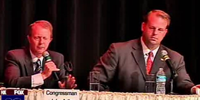 New Jersey Rep. John Adler, left, and ex-NFL lineman Jon Runyan participate in a debate Oct. 11. (MyFoxPhilly)