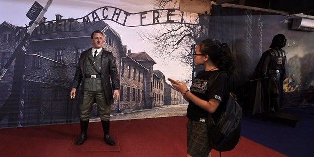 Museum-goers were allowed to take selfies with the Adolf Hitler wax figure.