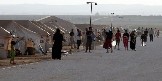 Syrian refugees gather at the Zaatari camp in Jordan, on July 31, 2012