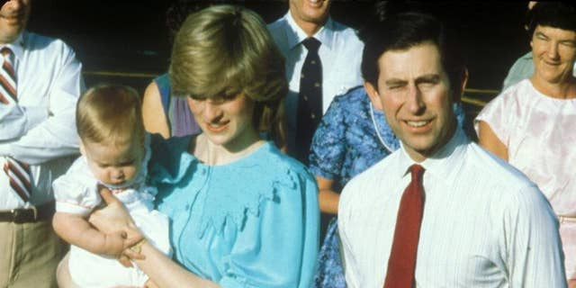 Prince Charles and Princess Diana arrive with Prince William in Alice Springs, Australia.