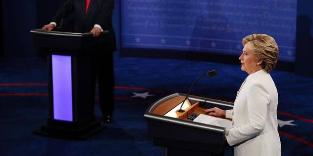 Democratic presidential nominee Hillary Clinton speaks as Republican presidential nominee Donald Trump listens during an October 2016 debate. (Mark Ralston/Pool via AP)