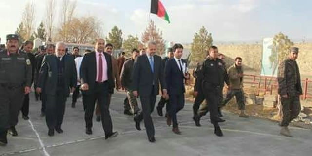 Afghan officials visiting Taliban prison hospitals.