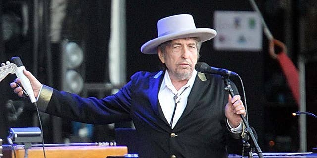 """FILE - This July 22, 2012 file photo shows U.S. singer-songwriter Bob Dylan performing on stage at """"Les Vieilles Charrues"""" Festival in Carhaix, western France.  The archives of Dylan have been acquired by the George Kaiser Family Foundation and the University of Tulsa and will be permanently housed in Tulsa. Kaiser Foundation director Ken Levit and university President Steadman Upham announced the acquisition Wednesday, March 2, 2016. (AP Photo/David Vincent, file)"""