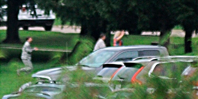 The Dayton Daily News reported that individuals were seen leaving the building with their hands in the air.