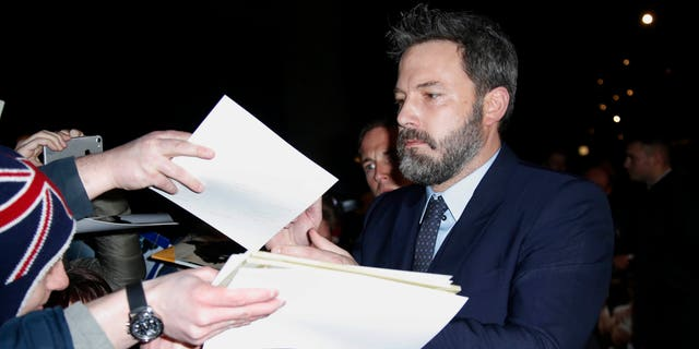 Actor Ben Affleck signs autographs upon arrival at the premiere of the film 'Live By Night' in London, Wednesday, Jan. 11, 2016. (Photo by Joel Ryan/Invision/AP)