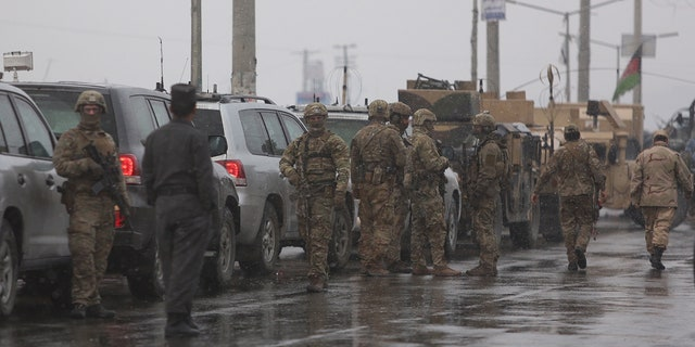 At least two Afghan soldiers were killed in the assault.