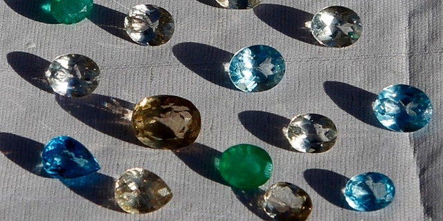 This March 2012 file photo shows gemstones on display at a shop inside a joint U.S.-Afghan military base in eastern Afghanistan.