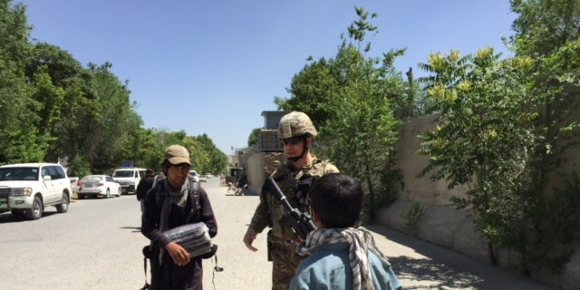 U.S troops with local Afghans in Kabul.
