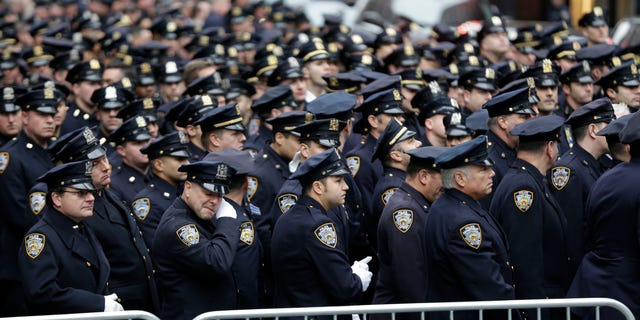 Police officers went to St. Patrick's Cathedral to pay their last respects to Joseph Lemm.