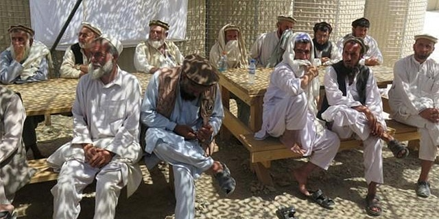 Afghan village elders sit at an Afghan and U.S. Special Forces base in Deh Bala district, Nangarhar province, Afghanistan July 7, 2018.