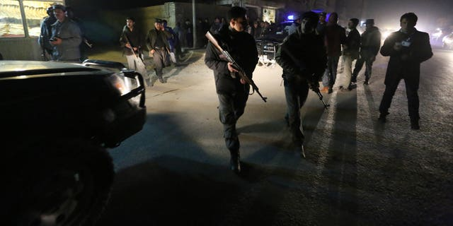 Afghan security forces inspect the site of an explosion in Kabul.
