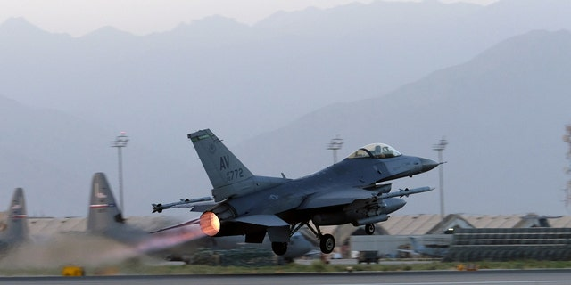 A U.S. Air Force F-16 Fighting Falcon aircraft takes off for a nighttime mission at Bagram Airfield, Afghanistan.