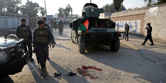 Afghan security police arrive at the scene of a suicide attack in Nangarhar province east of Kabul, Afghanistan, Thursday, Nov. 23, 2017.