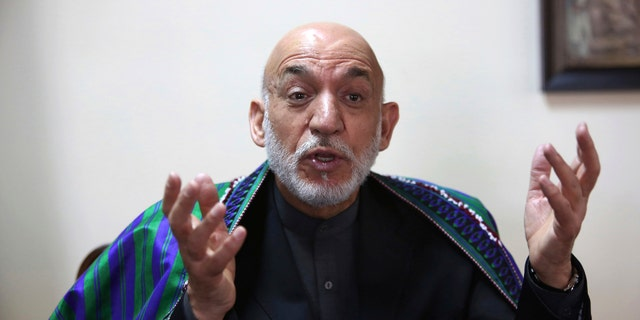 Former Afghan President Hamid Karzai speaks during an interview with the Associated Press in Kabul, Afghanistan, Monday, April 17, 2017.