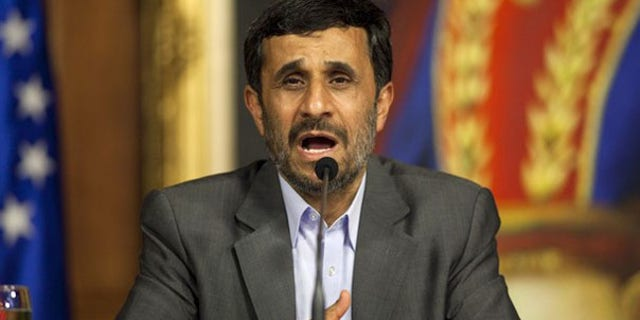 Iran President Mahmoud Ahmadinejad talks to the media in Caracas, Venezuela, Nov. 25. (Reuters Photo)