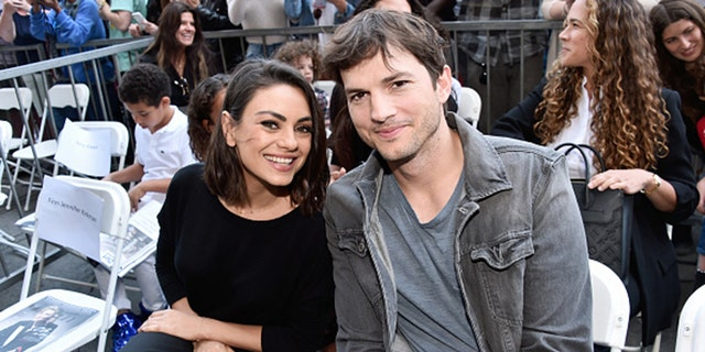 Actors Mila Kunis (L) and Ashton Kutcher sparked a huge online debate in July when they admitted that they don't bathe their children everyday.