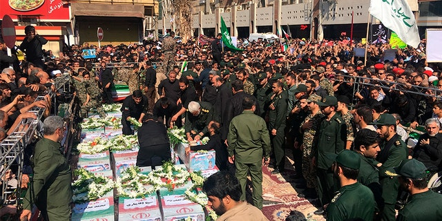 Caskets of those who died in an attack on a military parade in Iran are displayed in Ahvaz, Iran on Monday.