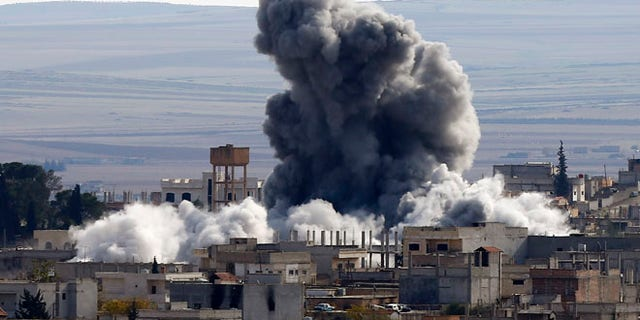 Nov. 23, 2014: An explosion following an air strike is seen in Kobani, Syria, near the Turkish border.