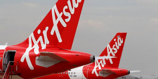 The 46-year-old AirAsia employee was pronounced dead by a doctor on the ground.