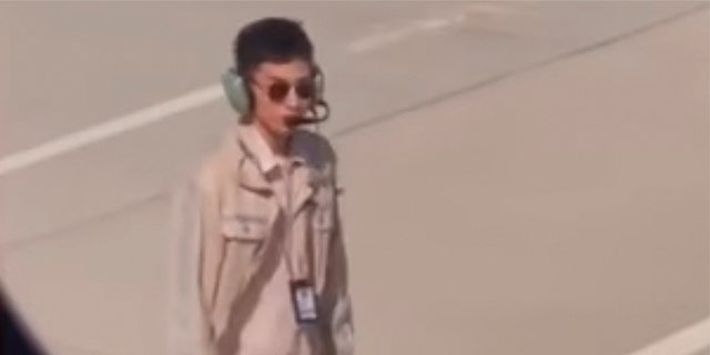 A 25-year-old airport employee reportedly got a 10 percent pay cut after a video of him looking hot at work went viral.