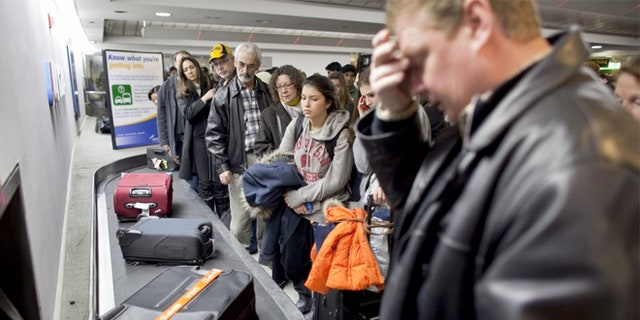 Checked bag fees have earned airlines big bucks.