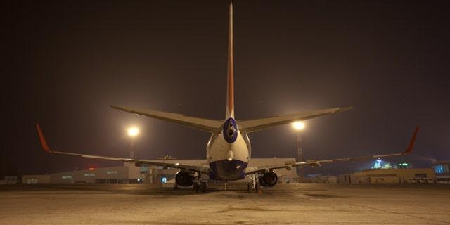 big air jet on ground at night