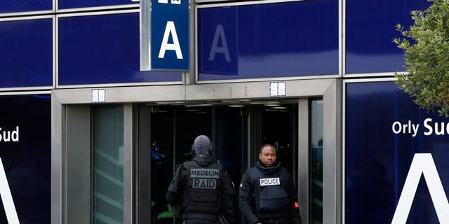French elite police forces patrol at the Orly airport departure terminal, south of Paris, Saturday, March, 18, 2017. A man was shot dead Saturday after wrestling a soldier to the ground at Paris' Orly Airport and trying to take her rifle, officials said. No one else in the busy terminal was hurt, but thousands of travelers were evacuated and flights were diverted to the city's other airport. (AP Photo/Thibault Camus)