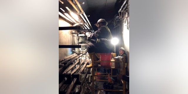 Workers for Georgia Power rushed to replace damaged power cables following the fire that caused the power outage.