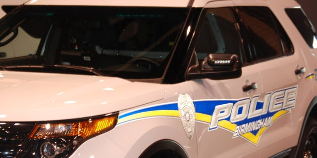 A pair of Birmingham police officers were injured while pursuing carjacking suspects.
