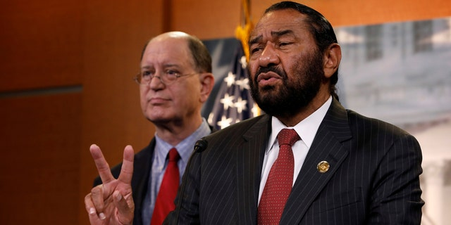 Rep. Al Green, D-Texas, and Rep. Brad Sherman, D-Calif., discuss impeachment efforts on Capitol Hill in 2017.