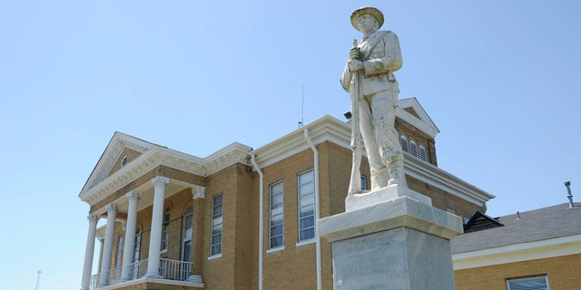 In this April 10, 2014, file photo, a Confederate monument stands outside the Choctaw County Courthouse in Butler, Ala.
