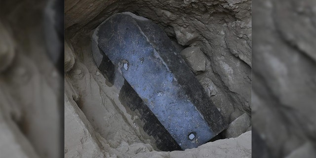 The sarcophagus lid and body have been sealed with mortar, which may indicate that it has not been opened since it was closed more than 2,000 years ago. (Egyptian Ministry of Antiquities)